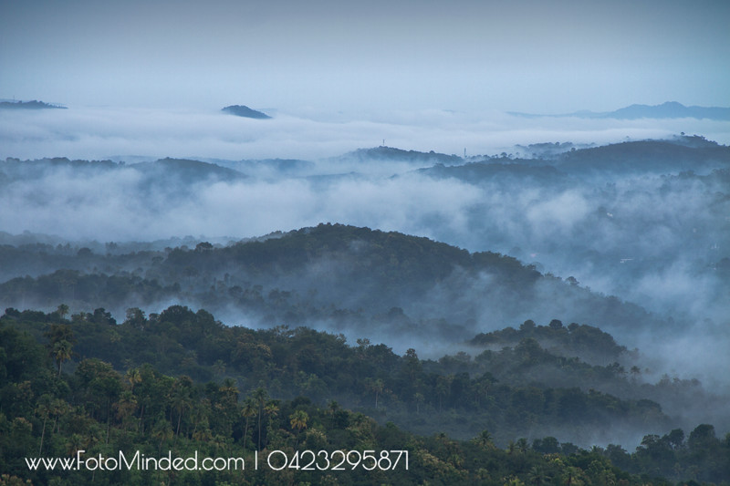 Shot this early in the morning from Chamundi Hill Palace Ayurveda Resort, Kanjirapalli, Kerala. This is a very common scene every morning from this view point.