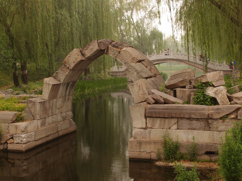 "20120513_1127_0270 one of the original bridges at 圆明园, '残桥 canqiao' (ruined bridge)  ""In its heyday YuanMingYuan had nearly 200 bridges. This bridge was a stone arch and bridge over a stream outside the west palace gate of Fuchun Hall. What has been left over is a single arch, the only preserved old stone bridge after Yuanmingyuan was destroyed [by European forces in the 1865 Second Opium war and 1900 Boxer Rebellion].""  (Beijing time 0927)"