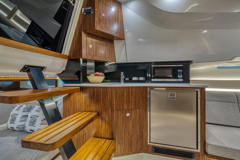 2021-Sundancer-370-Outboard-DAO370-galley-microwave-refrigerator-04924.jpg