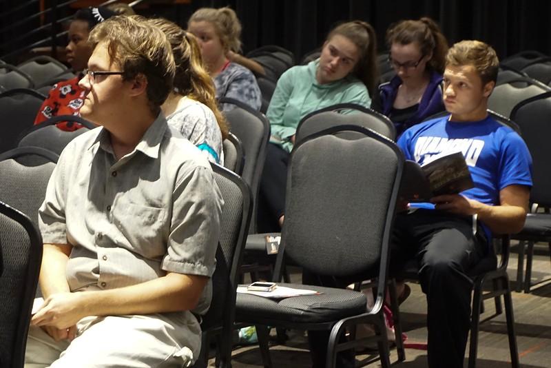 Cameron Reeder listens alongside his peers as Dr. Carey Poole discusses Title IX