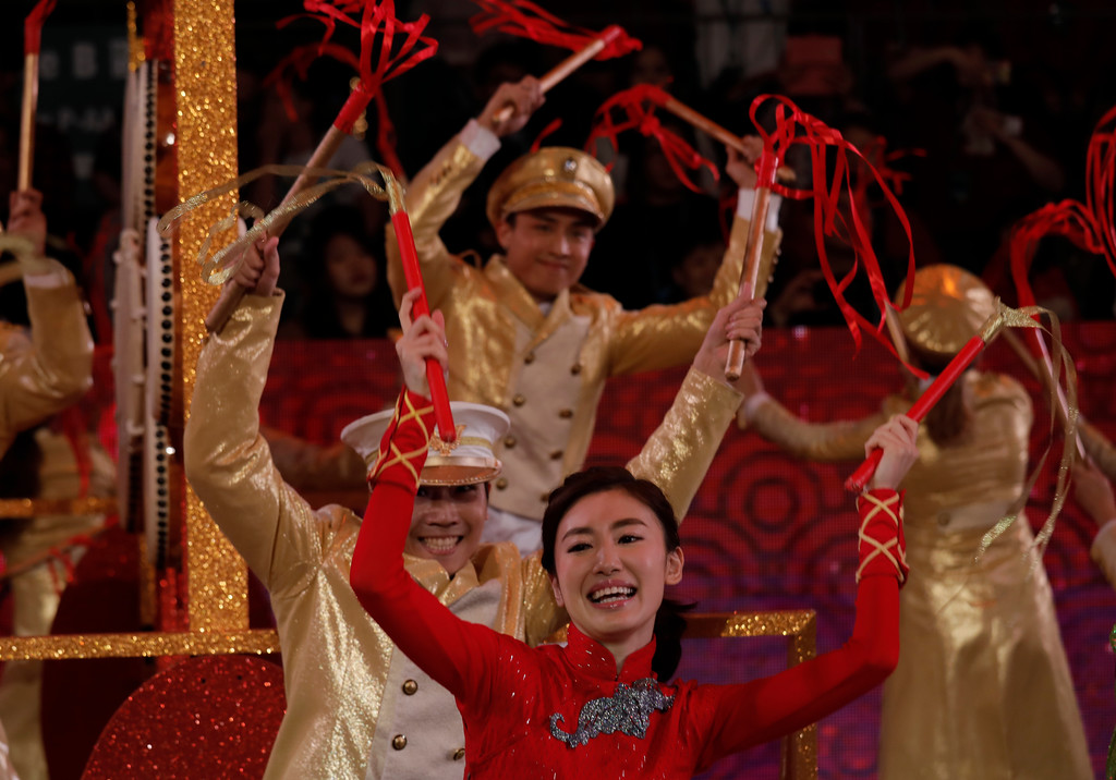 . Performers take part in a night parade to celebrate Chinese New Year in Hong Kong Friday, Feb. 16, 2018. The Lunar New Year this year marks the Year of the Dog in the Chinese calendar. (AP Photo/Vincent Yu)
