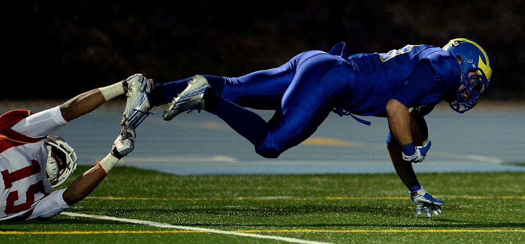 . San Dimas\' Joseph Mayorga (23) dives for the winning touchdown as Paraclete\'s Triston Brown (15) tries to tackle in the fourth quarter of a CIF-SS Mid-Valley Division championship football game at San Dimas High School in San Dimas, Calif., on Friday, Dec. 6, 2013. San Dimas won 20-14.  (Keith Birmingham Pasadena Star-News)