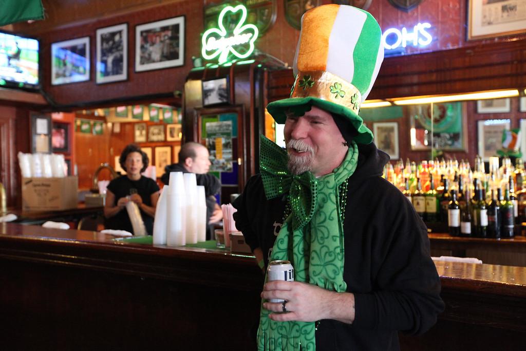 . Duane Bohmier celebrates on St. Patrick\'s Day at Nemo\'s in Detroit before the crowds arrive on Monday, March 17, 2014. (AP Photo/Detroit Free Press, Jessica J. Trevino)