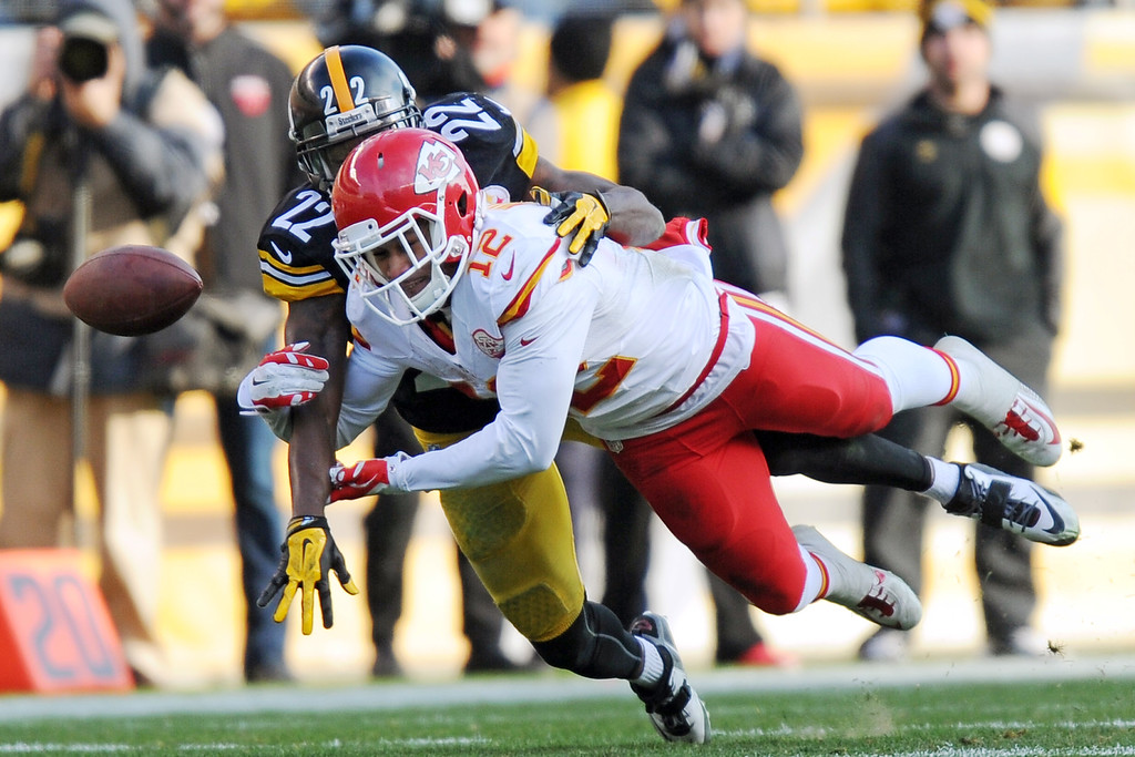 . Pittsburgh Steelers cornerback William Gay (22) breaks up a pass intended for Kansas City Chiefs wide receiver Albert Wilson (12)  during the second half of an NFL football game in Pittsburgh, Sunday, Dec. 21, 2014. (AP Photo/Don Wright)