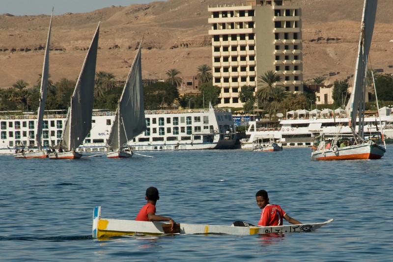 Boys riding a boat on Nile River - Aswan, Egypt