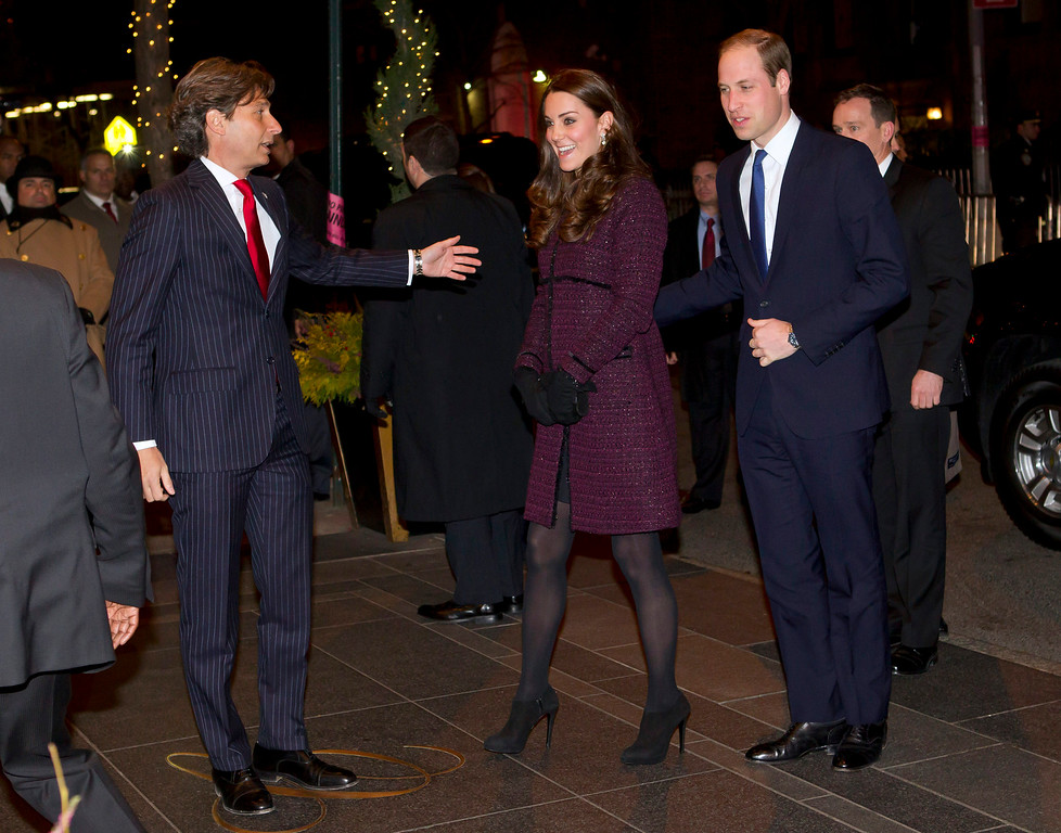 . Kate, center, Duchess of Cambridge and Britain\'s Prince William, right, are greeted by The Carlyle hotel manager Giovanni Beretta, Sunday, Dec. 7, 2014, in New York. The Duke and Duchess of Cambridge have a full schedule of events in New York, including a visit to the National Sept. 11 Memorial and Museum and an NBA basketball game between the Brooklyn Nets and the Cleveland Cavaliers. (AP Photo/New York Post, Chad Rachman, Pool)