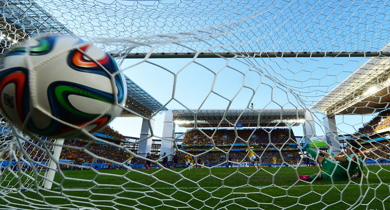 . Colombia\'s midfielder Juan Guillermo Cuadrado (C) scores a penalty during a Group C football match between Japan and Colombia at the Pantanal Arena in Cuiaba during the 2014 FIFA World Cup on June 24, 2014. (LUIS ACOSTA/AFP/Getty Images)