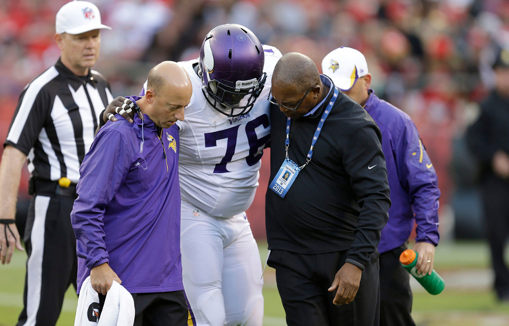 . Vikings defensive tackle Anthony McCloud is helped off the field during the third quarter after an injury against the 49ers. (AP Photo/Ben Margot)