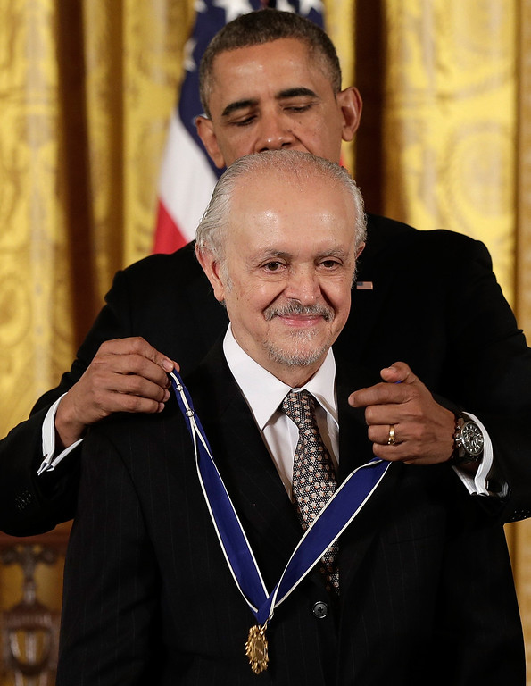 . U.S. President Barack Obama awards the Presidential Medal of Freedom to Mario Molina in the East Room at the White House on November 20, 2013 in Washington, DC.   (Photo by Win McNamee/Getty Images)
