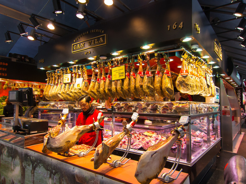Jamón stand at the market. The ham-hock holders here are common in many restaurants and bars, too.