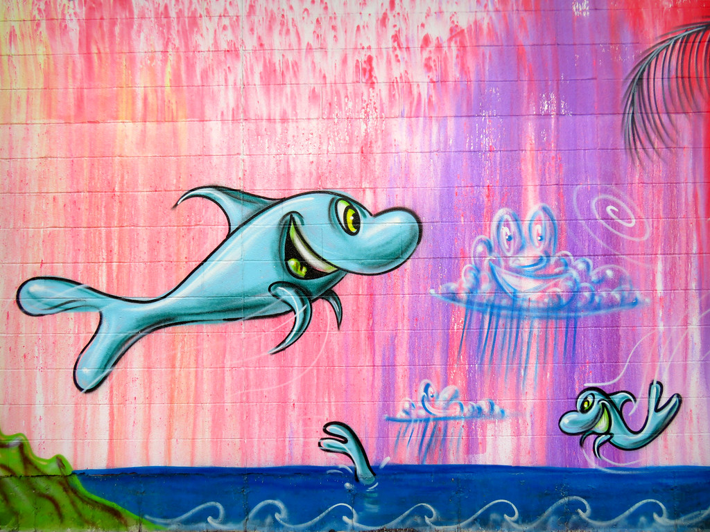 kenny scharf mural on the side of Krinos food - fish