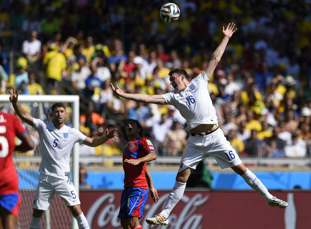 . England\'s defender Phil Jones heads the ball during the Group D football match between Costa Rica and England at The Mineirao Stadium in Belo Horizonte on June 24, 2014,during the 2014 FIFA World Cup. FABRICE COFFRINI/AFP/Getty Images