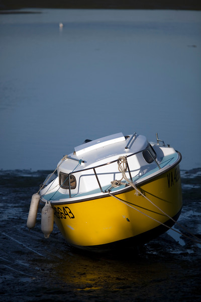 Aground boat at low tide, Conleau island, town of Vannes, departament of Morbihan, region of Brittany, France