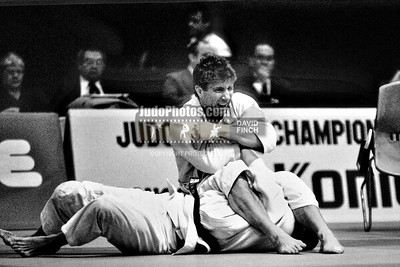 1989 Belgrade Worlds 891012A1327: Michael Swain of the USA sweeps past fellow North American Roman Hatashita of Canada in the eliminations with juji gatame.....