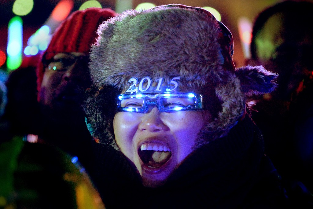 . A woman cheers for celebrating upcoming new year during a New Year\'s Eve countdown event in front of Beijing\'s National Stadium, Known as the Bird\'s Nest in Beijing on December 31,2014. Beijing is bidding to host the 2022 Winter Olympic Games, with a decision on the winning city to be made in July 2015. AFP PHOTO / WANG ZHAOWANG ZHAO/AFP/Getty Images