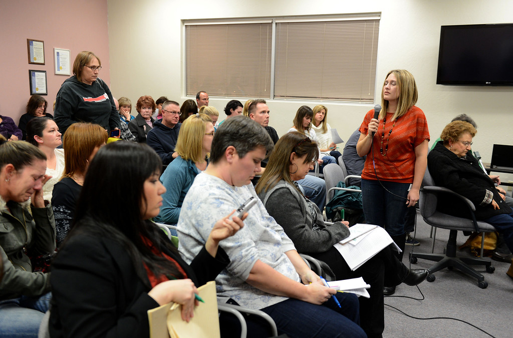 . An upset Stephanie Stewart, right, a parent of a special needs child, uses the remaining allotted time for her comment to the Brentwood Union School District board to stand in silence as she represents how hard it is for a special needs child to communicate, at the board\'s meeting in Brentwood, Calif., on Wednesday, Jan. 23, 2013.  Stewart spoke of  her son Dylan\'s former teacher, Dina Holder, who was convicted of misdemeanor child abuse and was transferred to a different teaching position. (Susan Tripp Pollard/Staff)