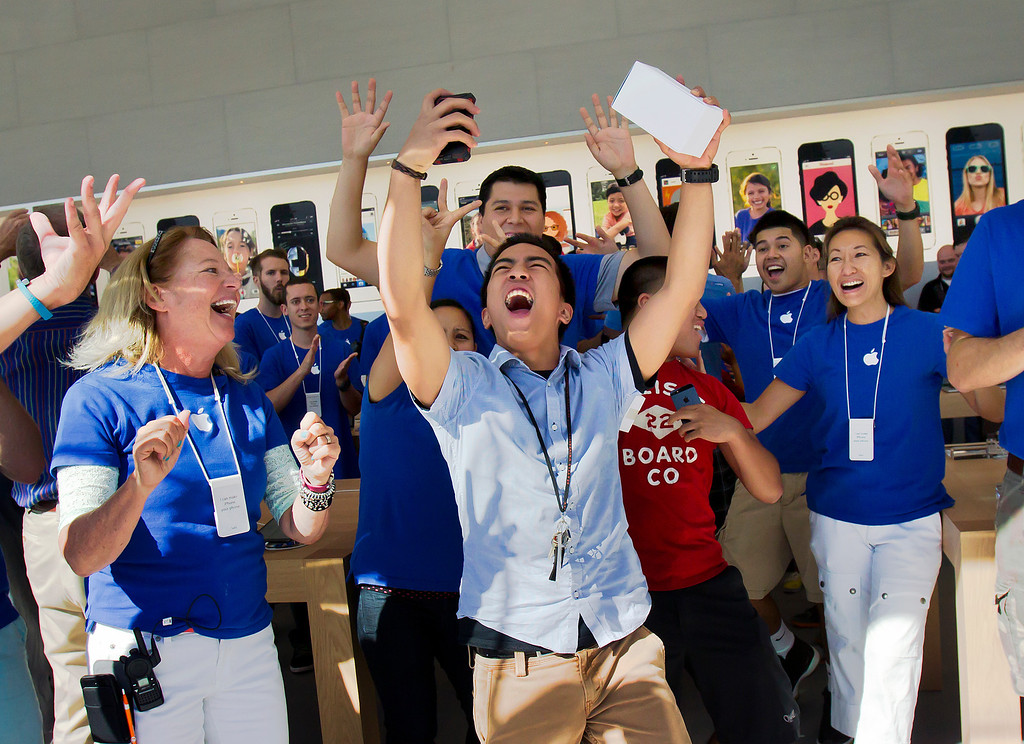 . Jan Monge cheers for his selfie as he enters the redesigned Apple Store at the Stanford Shopping Center in Palo Alto, Calif., on Saturday, Sept. 7, 2013.  (LiPo Ching/Bay Area News Group)