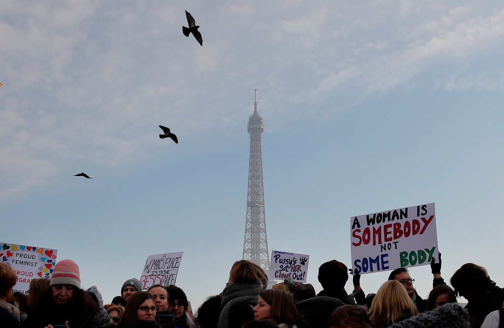 . Protesters carrying banners and placards take part in a Women\'s March next to the Eiffel Tower, in Paris, France, Saturday, Jan. 21, 2017. The march is part of a worldwide day of actions following the inauguration of U.S President Donald Trump. (AP Photo/Christophe Ena)