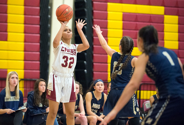 01/0719 Wesley Bunnell | StaffrrNew Britain girls basketball vs Newington at NBHS on Tuesday evening. Raven Simone Jarrett (32) with a shot.