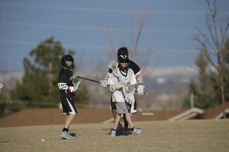 JPM0488-JPM0488-Jonathan first HS lacrosse game March 9th.jpg