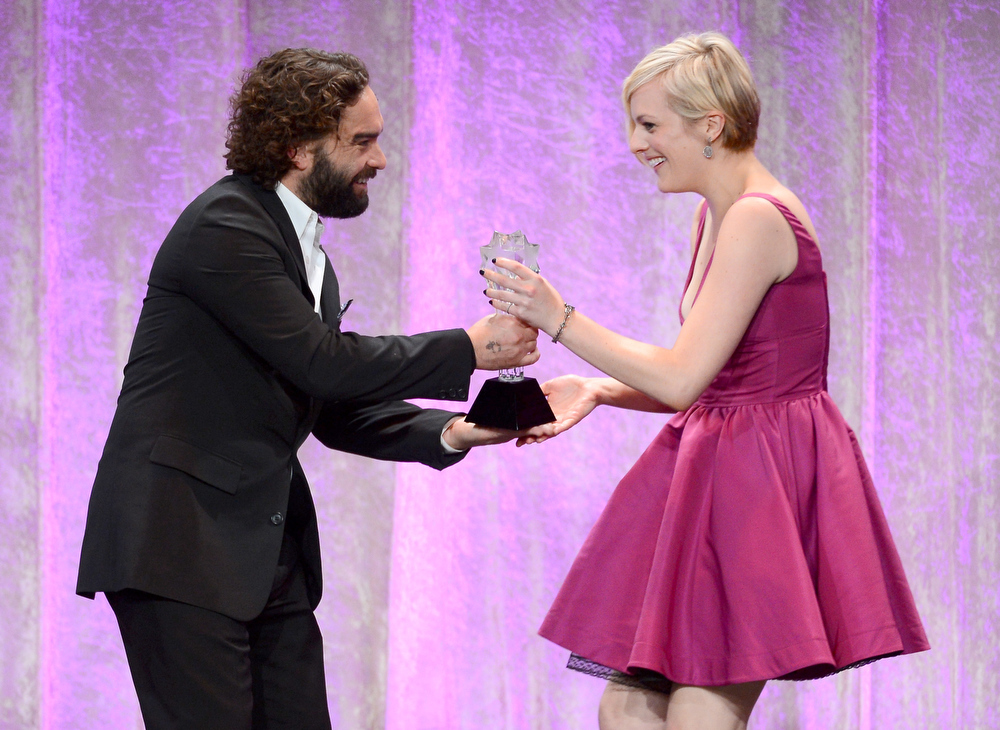 ". Actor Johnny Galecki presents the Best Actress in a Movie or Miniseries award for ""Top of the Lake\"" to Elisabeth Moss onstage during Broadcast Television Journalists Association\'s third annual Critics\' Choice Television Awards at The Beverly Hilton Hotel on June 10, 2013 in Los Angeles, California.  (Photo by Mark Davis/Getty Images for CCTA)"