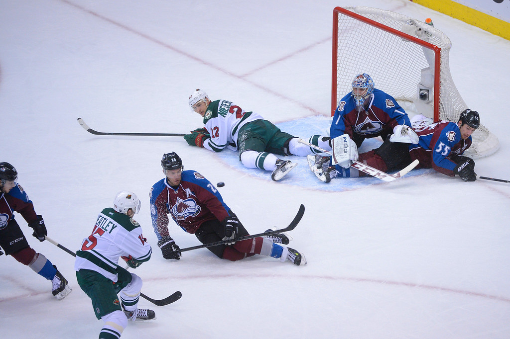 . Dany Heatley (15) of the Minnesota Wild takes a shot on goal during the first period of action.   (Photo by Karl Gehring/The Denver Post)