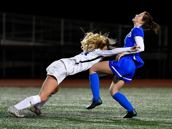 11/23/2019 Mike Orazzi | Staff Southington High School's Jessica Carr (4) and Glastonbury's Sophia Haussmann (15) during the Class LL Girls State Soccer Tournament at Veterans Stadium in New Britain Saturday evening. Glastonbury won 1-0.