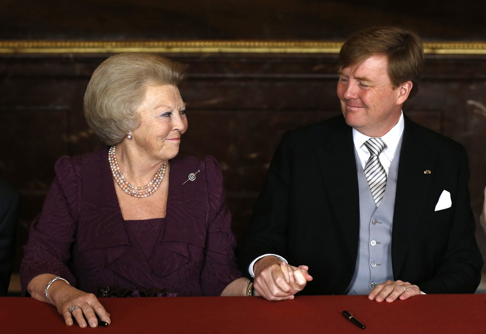 . Queen Beatrix of the Netherlands (L) and her son Prince Willem-Alexander attend the Abdication ceremony at the Royal Palace in Amsterdam on April 30, 2013.  BART MAAT/AFP/Getty Images