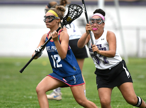 5/31/2018 Mike Orazzi | Staff St. Paul's St. Paul's Christina Pisani (12) and North Branford High School's Jasmine Coleman (37) during the girls Class S Quarterfinals lacrosse at North Branford High School Thursday evening.