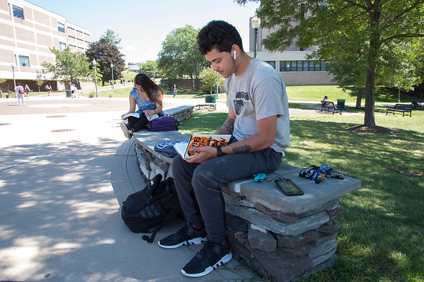 08/29/19 Wesley Bunnell | Staff Victor Montanez takes advantage of the warm weather to study outside on CCSU's campus on August 29, 2019.