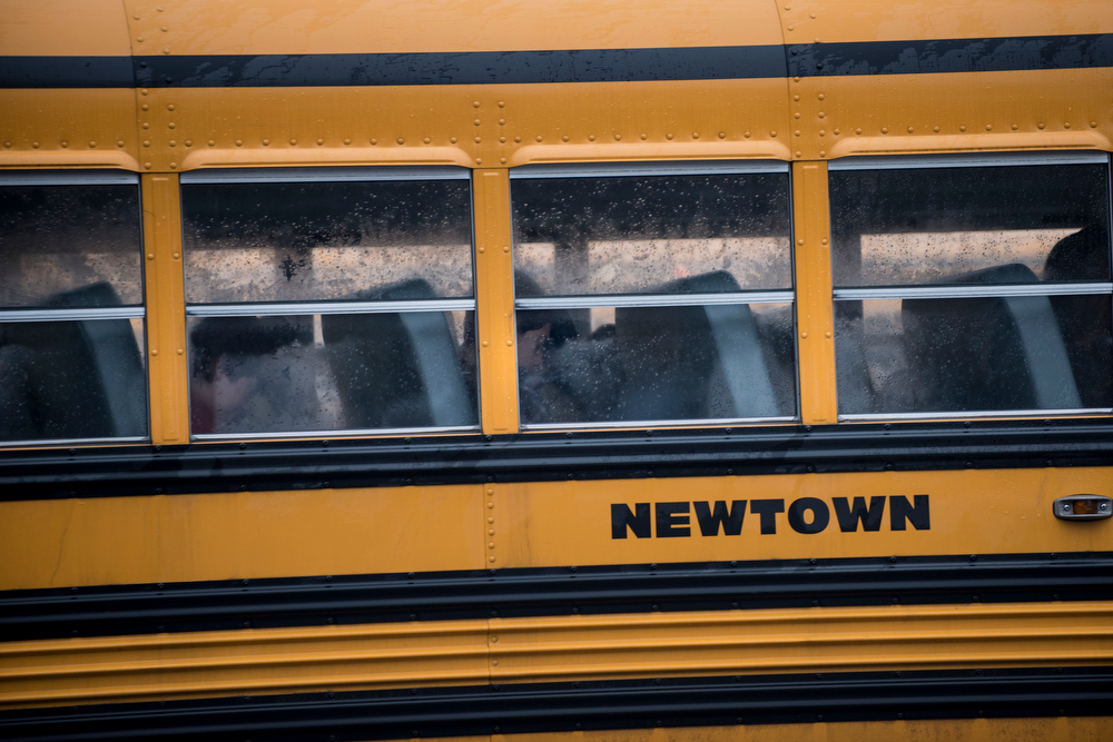 Description of . A school bus takes students to Newtown High School December 18, 2012 in Newtown, Connecticut. Students in Newtown, excluding Sandy Hook Elementary School, return to school for the first time since last Friday's shooting at Sandy Hook which took the live of 20 students and 6 adults.  BRENDAN SMIALOWSKI/AFP/Getty Images