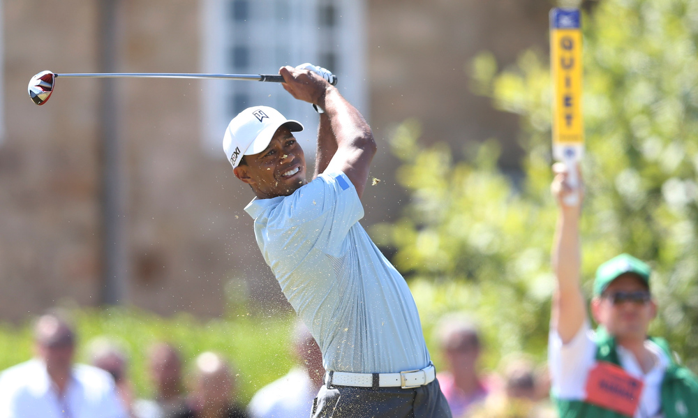 . Tiger Woods of the United States plays a shot off the 10th tee during the second round of the British Open Golf Championship at Muirfield, Scotland, Friday July 19, 2013. (AP Photo/Scott Heppell)