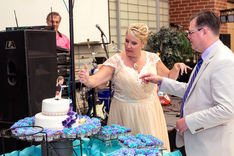 Bride Stabbing the cake.jpg