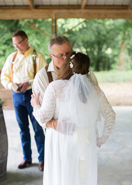 Groom and Bride Kiss at Wedding at Nolichucky Vineyard by Everbright Photography