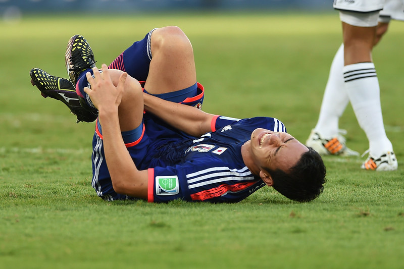 . Japan\'s defender Maya Yoshida falls to the ground in pain during a Group C football match between Japan and Colombia at the Pantanal Arena in Cuiaba during the 2014 FIFA World Cup on June 24, 2014. (TOSHIFUMI KITAMURA/AFP/Getty Images)