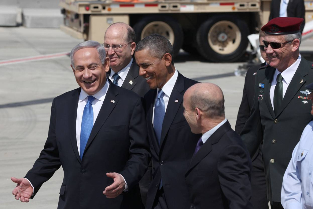 . U.S. President Barack Obama (C) is greeted by Israeli Prime Minister Benjamin Netanyahu (L) and Defense Minister Moshe Ya\'alon (2L) during an official welcoming ceremony on his arrival at Ben Gurion International Airport on March, 20, 2013 near Tel Aviv, Israel. (Photo by Marc Israel Sellem-Pool/Getty Images)