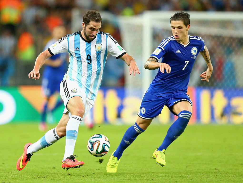 . Gonzalo Higuain of Argentina and Muhamed Besic of Bosnia and Herzegovina battle for the ball  during the 2014 FIFA World Cup Brazil Group F match between Argentina and Bosnia-Herzegovina at Maracana on June 15, 2014 in Rio de Janeiro, Brazil.  (Photo by Ronald Martinez/Getty Images)