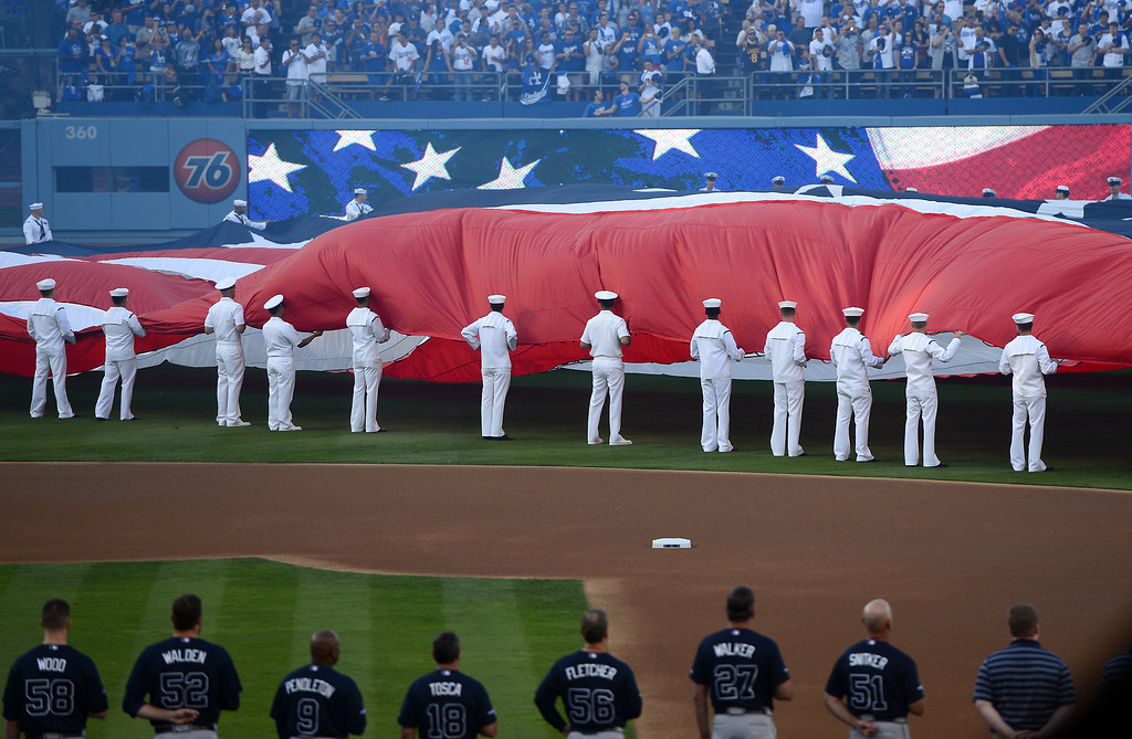 . Fans cheer as the American Flag is displayed before game 3 of the NLDS at Dodger Stadium Sunday, October 6, 2013. (Photo by Sarah Reingewirtz/Los Angeles Daily News)