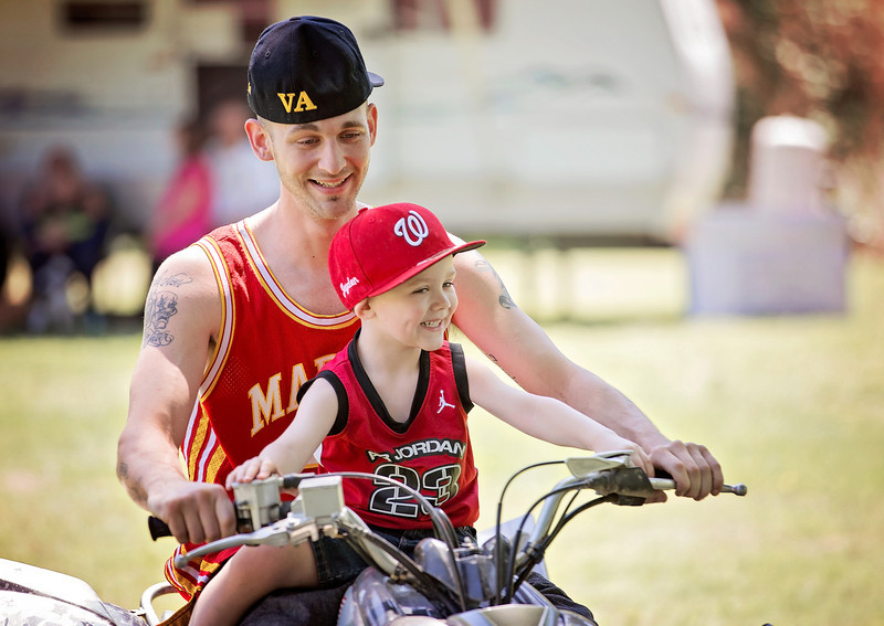 Jayden and Father on ATV 1.jpg