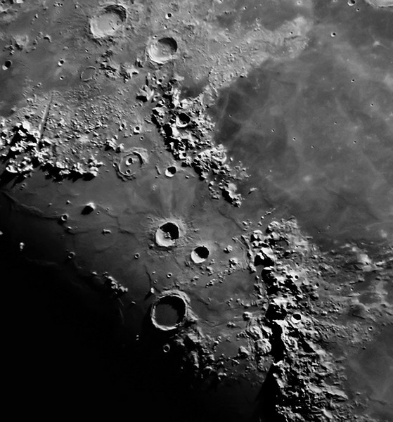 The Appennies, the moon's finest mountain range is the subject of this picture. The craters Aristoteles and Eudoxus are the the largest formations on the top. The Alpine Valley is clearly visible on the left side and a pair of craters within the Cassini  crater is next as we move right. Just below center the large craters Aristillus, Autolycus and Archimedes. The shadow of the sharp clefts surrounding Archimedes project on to the floor of the  immense crater, which is only partially lit by the sun. The trio of craters form a small arrow pointing to Palus Putredinis and near the landing site of Apollo 15 by Mt Hadley.      Image taken with the 10 inch refractor telescope at Mingo Observatory - Al Paslow & Paul Campbell.