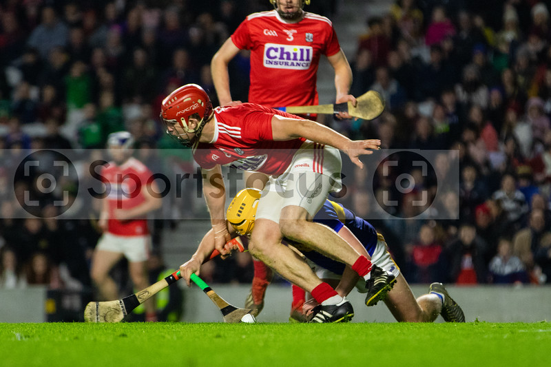 Tipperary's Mark Kehoe is fouled by Cork's Bill Cooper for a Tipperary penalty