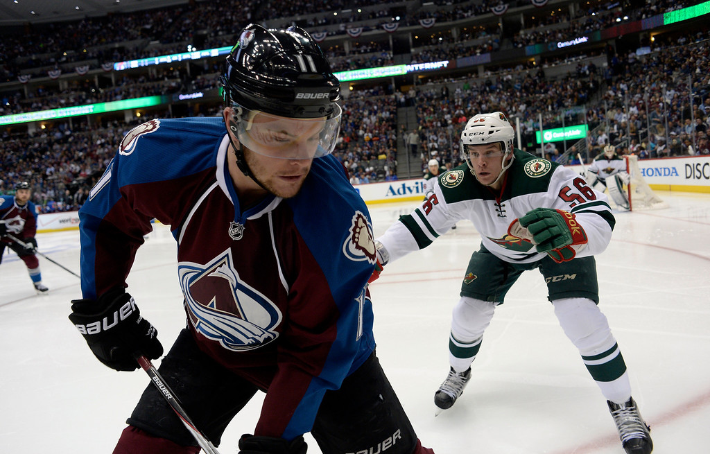 . DENVER, CO - APRIL 26: Colorado Avalanche left wing Jamie McGinn (11) works for the puck against Minnesota Wild left wing Erik Haula (56) during the second period of action. The Colorado Avalanche hosted the Minnesota Wild in the fifth round of the Stanley Cup Playoffs at the Pepsi Center in Denver, Colorado on Saturday, April 26, 2014. (Photo by John Leyba/The Denver Post)