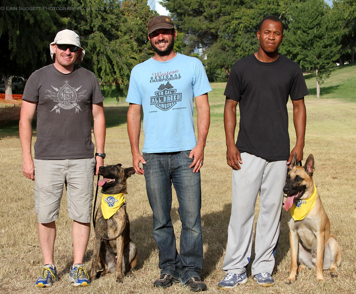 CGC Evaluator, Cary Petersen, with Josh McCleary & Hector and Raymond Williams & Blaze after successfully completing their Canine Good Citizen tests.