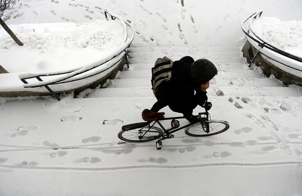 . LITTLETON, CO. - MARCH 23:  A commuter passes through the RTD station in downtown Littleton, CO March 23, 2013. The Saturday forecast calls for snow accumulation of 9 to 12 inches with highs in the lower to mid 20s. (Photo By Craig F. Walker/The Denver Post)