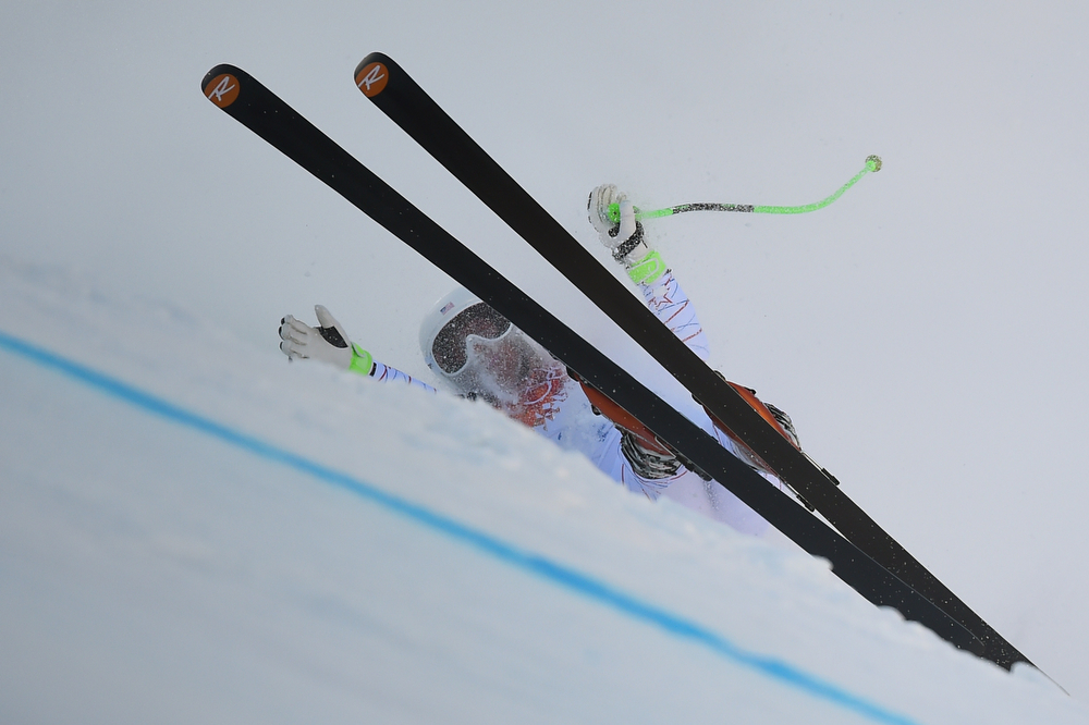 . US skier Stacey Cook falls during the Women\'s Alpine Skiing Super-G at the Rosa Khutor Alpine Center during the Sochi Winter Olympics on February 15, 2014.  (FABRICE COFFRINI/AFP/Getty Images)
