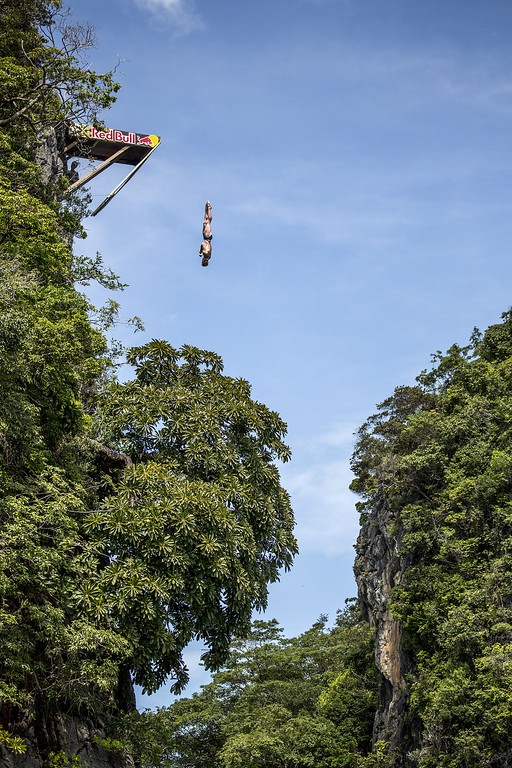 . In this handout image provided by Red Bull, Andy Jones of the USA dives from the 27 meter platform at training on Hong Island in the Andaman Sea during the final stop of the 2013 Red Bull Cliff Diving World Series on October 25, 2013 at Krabi, Thailand. (Photo by Romina Amato/Red Bull via Getty Images)