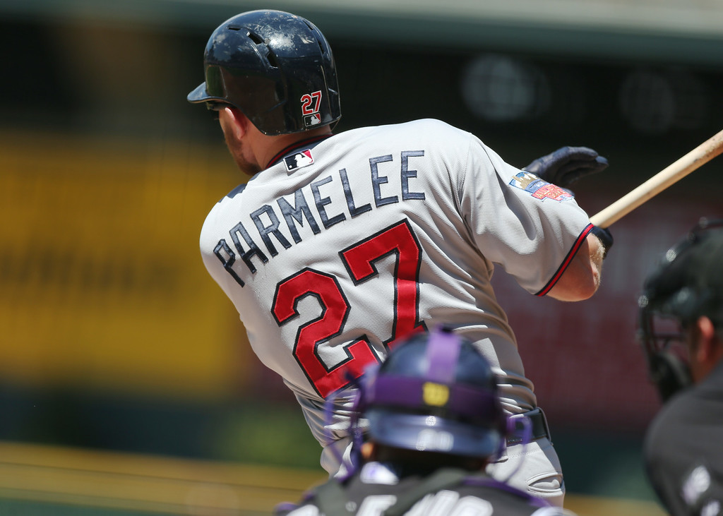 . Minnesota Twins\' Chris Parmelee singles to drive in two runs against the Colorado Rockies in the first inning of an interleague baseball game in Denver on Sunday, July 13, 2014. (AP Photo/David Zalubowski)