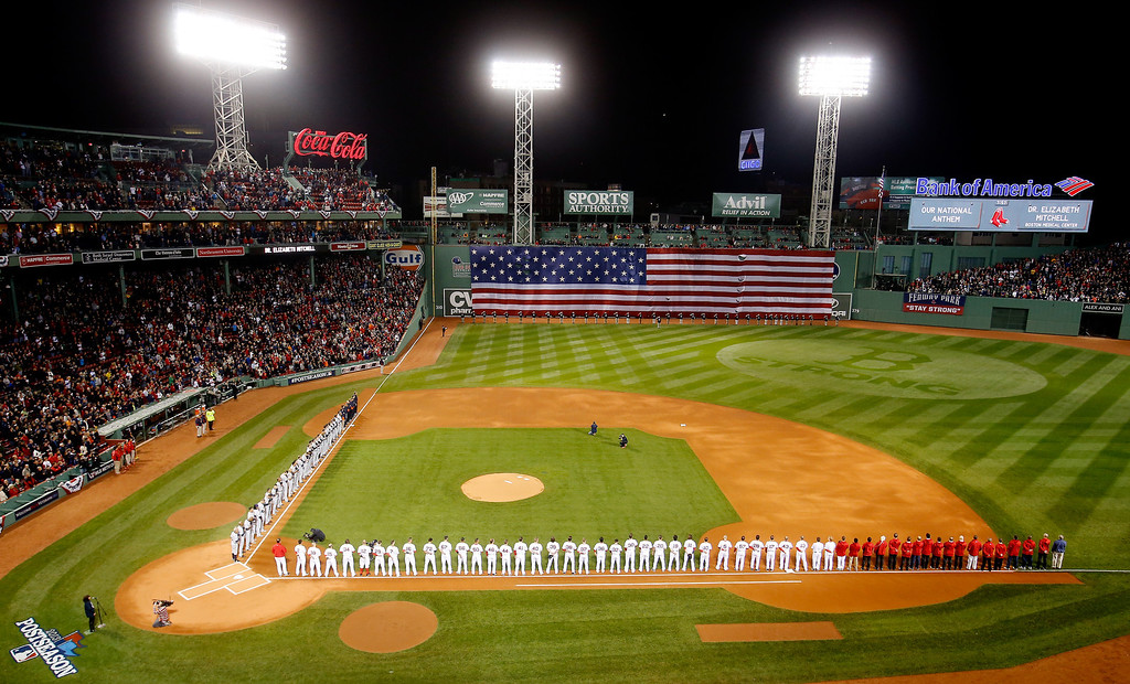 . BOSTON, MA - OCTOBER 12: The Boston Red Sox and the Detroit Tigers line up for the national anthem before Game One of the American League Championship Series at Fenway Park on October 12, 2013 in Boston, Massachusetts.  (Photo by Jim Rogash/Getty Images)