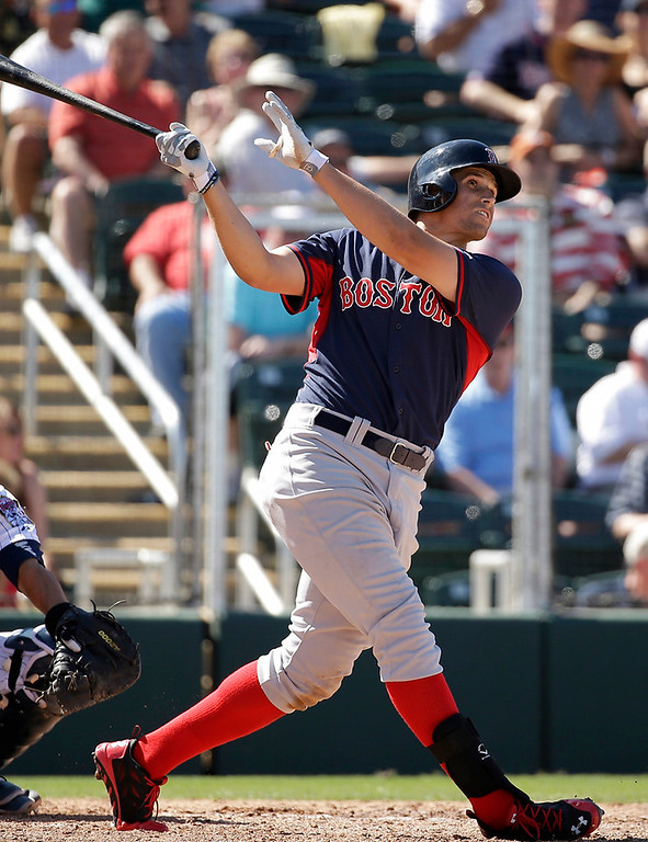 . Boston Red Sox\'s Garin Cecchini follows through on a swing during an at bat in the fourth inning of an exhibition baseball game against the Minnesota Twins, Saturday, March 1, 2014, in Fort Myers, Fla. (AP Photo/Steven Senne)