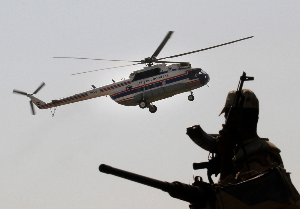 . An Egyptian soldier stands guard as a helicopter carrying former Egyptian President Hosni Mubarak, 85, lands at Maadi Military Hospital from Torah Prison in, Cairo, Egypt, Thursday, Aug. 22, 2013. Egypt\'s ousted leader Hosni Mubarak has been released from jail and taken to military hospital in Cairo. (AP Photo/Amr Nabil)